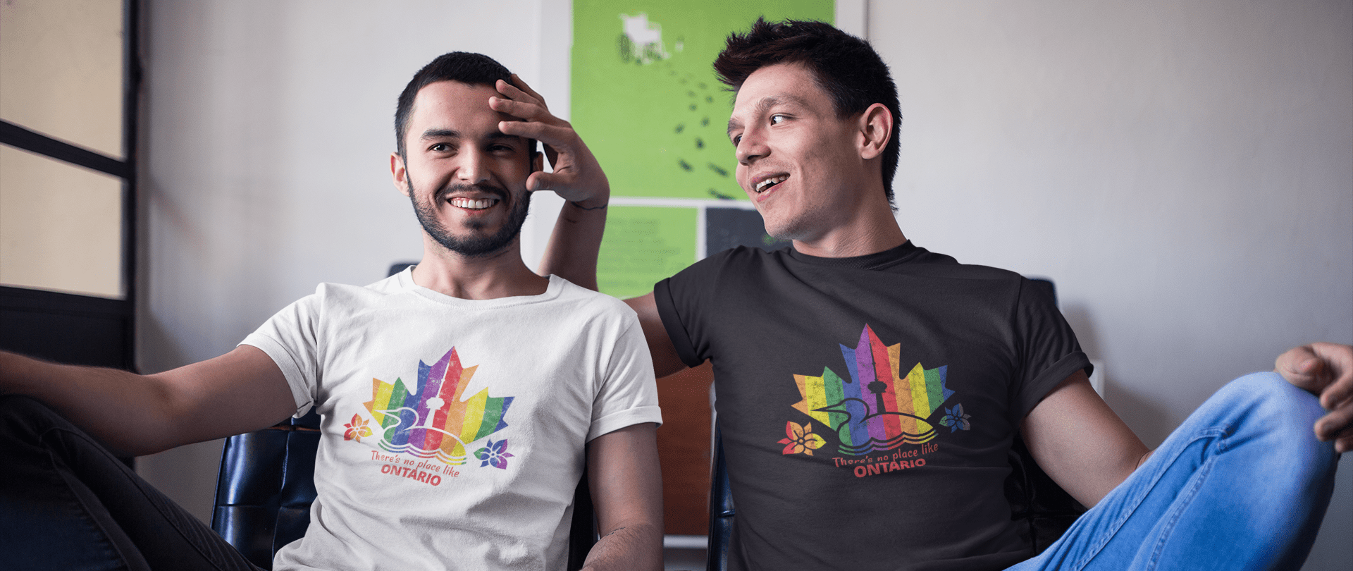 Two men seated beside each other wearing Ontario Pride t-shirts