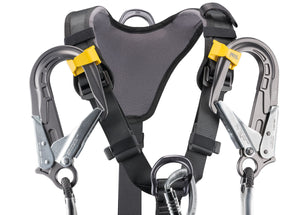 Black harness with yellow highlights showing yellow lanyard clips