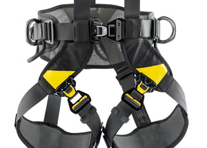 Black harness with yellow highlights legging close up