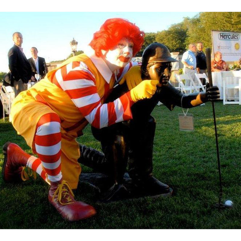 Bronze Statue of a Man Playing Golf with Ronald McDonald
