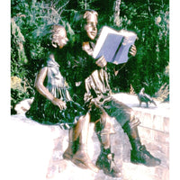 Bronze Statue of a Boy and Girl Reading a Book