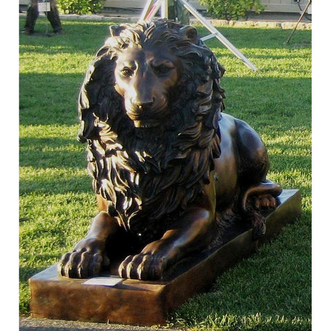 Pair of Crouching Palace Lion Statues