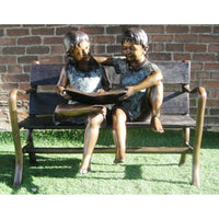boy and girl reading a book bronze sculpture for library