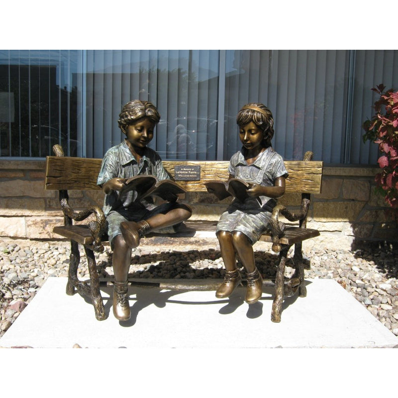 Bronze Statue of Boy and Girl Reading a Book