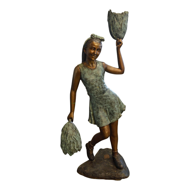 bronze statue of a girl cheeleading