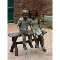 Bronze Statue of  Two Children Reading on a Bench