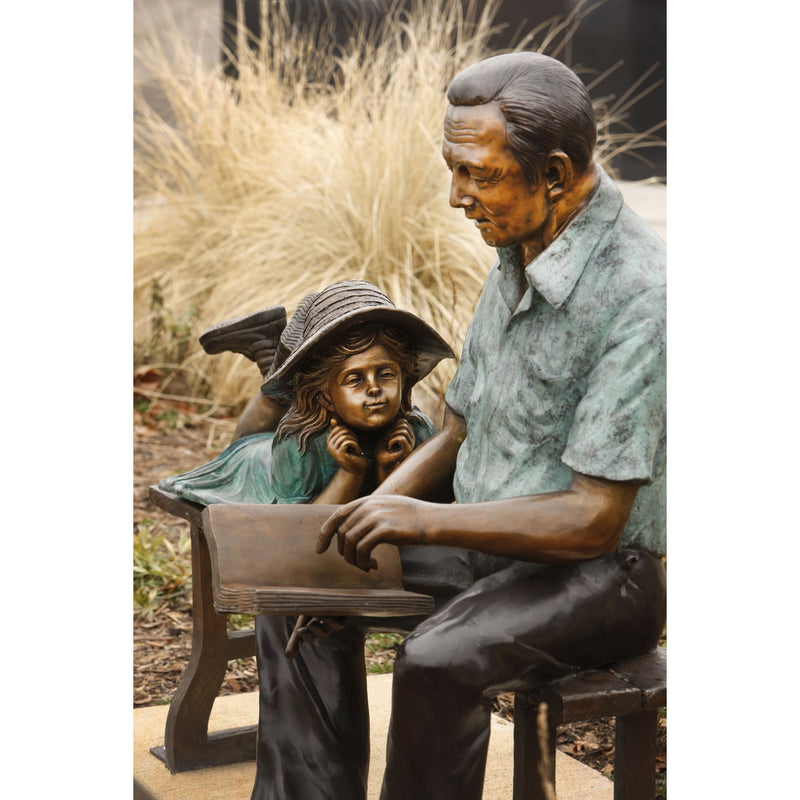 Grandfather and Granddaughter Bronze Statue on Bench Reading