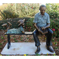 Bronze Statue of a Grandfather Man on Bench Reading a Book to a Girl