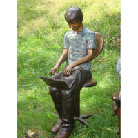 Bronze Statue of Boy Reading Laptop