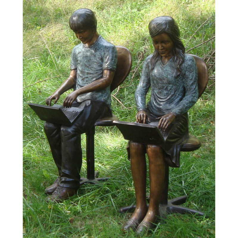 Bronze Statue of Girl Reading Laptop
