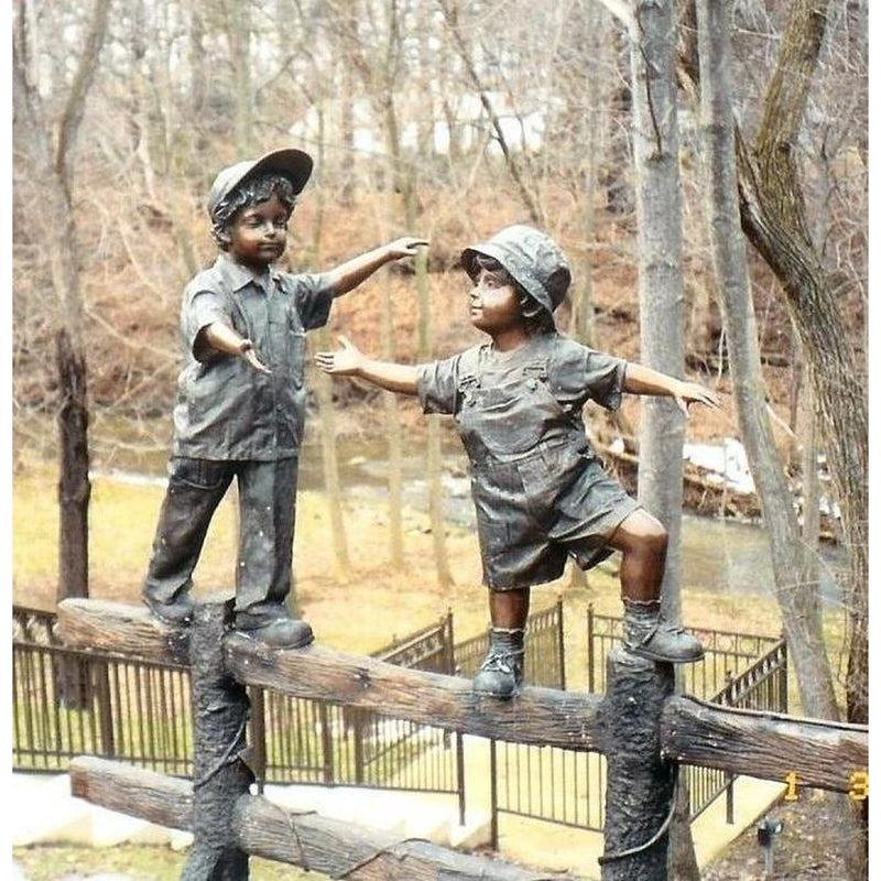 Balancing Act -bronze statue of 2 boys on fence fountain