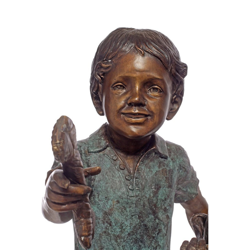 Bronze Statue of a Boy Playing with a Dog