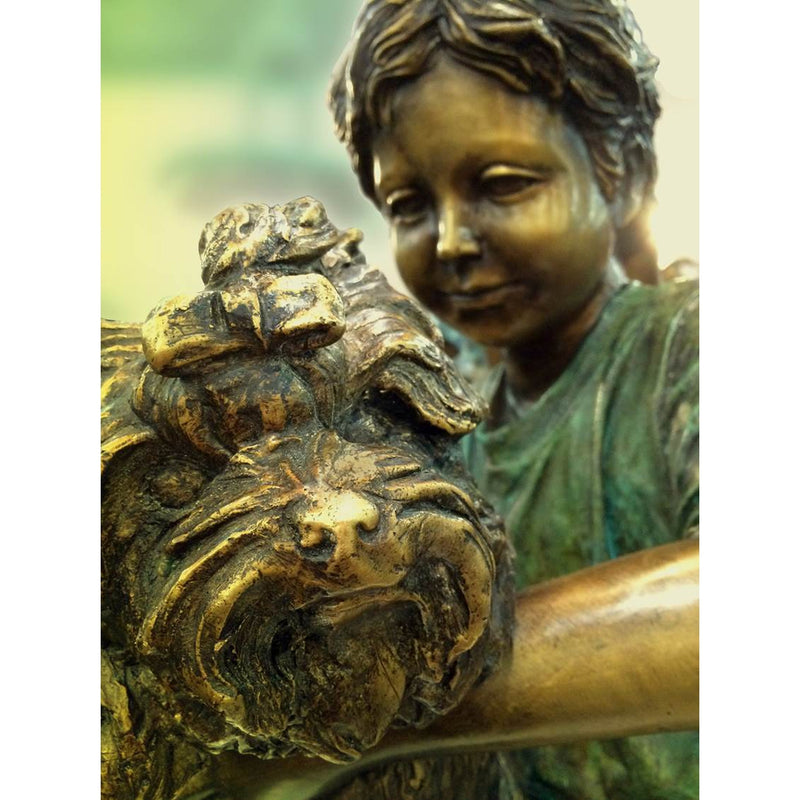 Boy holding puppy dog bronze statue