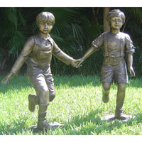 Bronze Statue of a Boy and Girl Playing - Holding Hands