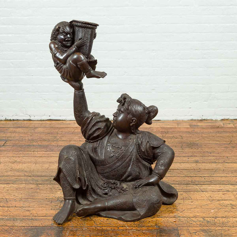 Japanese Style Bronze Sculpture of a Seated Woman Holding a Mythical Creature