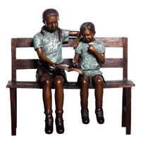 Bronze Statue of a Boy and Girl - Children Reading a Book on a Bench