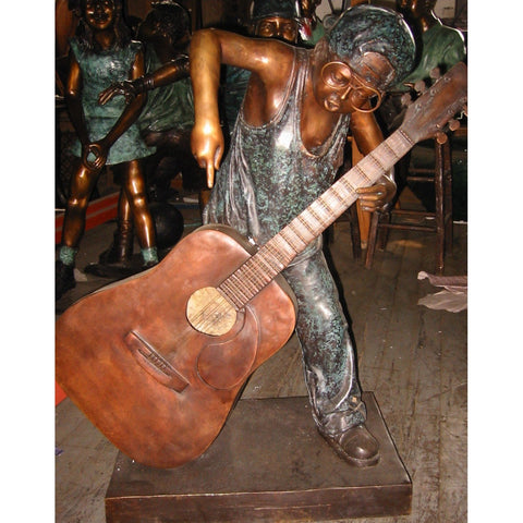 Bronze Statue of a Boy with a Guitar