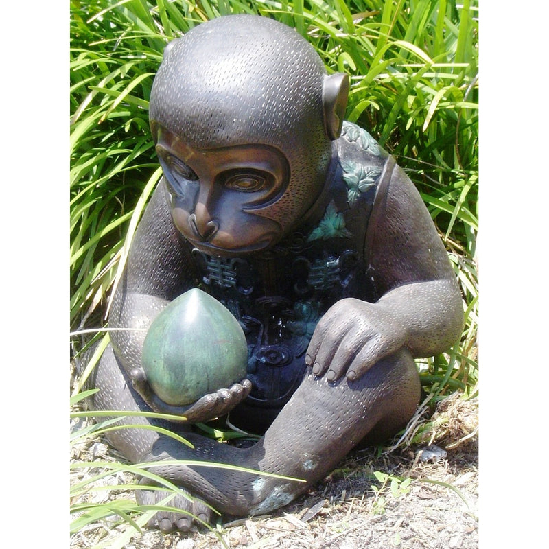 Bronze Monkey statue holding a peach