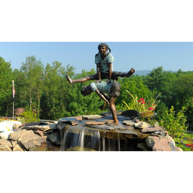 RG642-Leap Frog Children Bronze Statue at Camp
