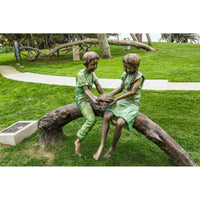 Bronze Sculpture and Fountain of Two Children Sitting on a Log Holding a Turtle