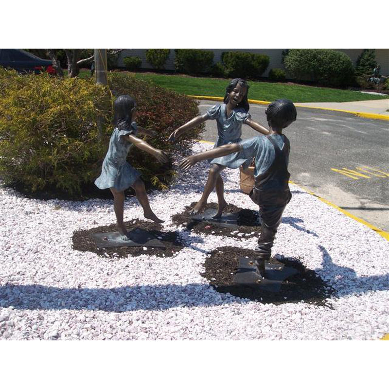 Bronze Statue of a Boy and Two Girls Holding Hands and Dancing in a Circle
