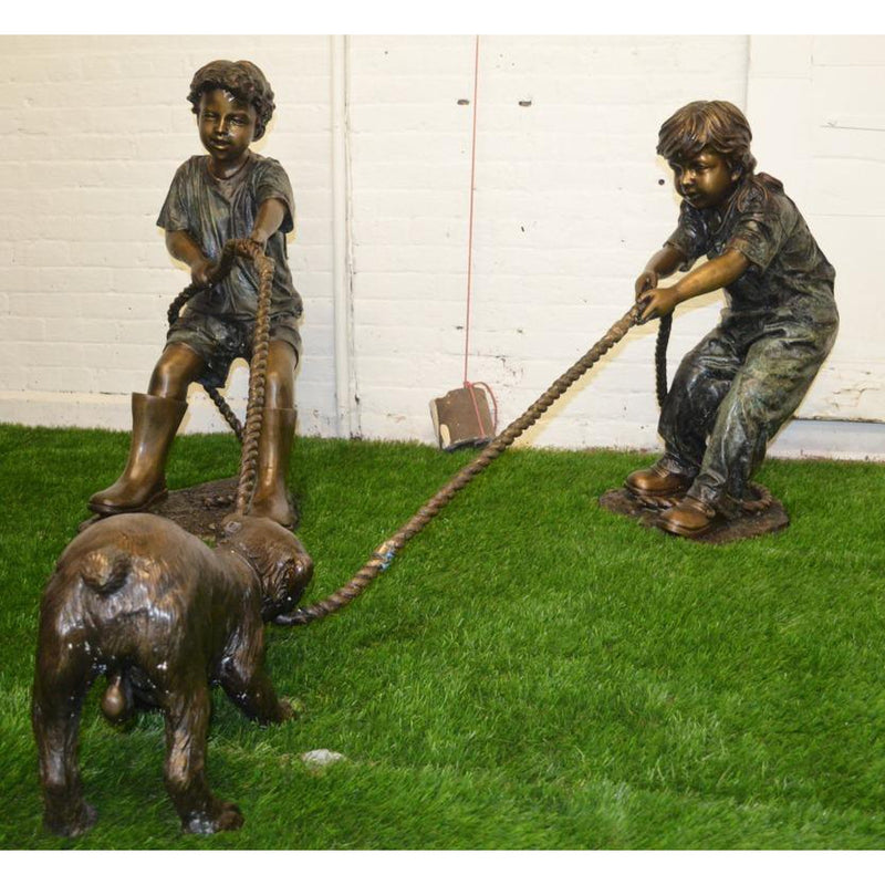 Bronze Statue of Children Playing with a Dog