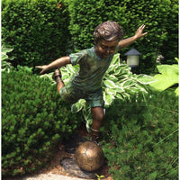Bronze Statue of a Boy Playing Soccer