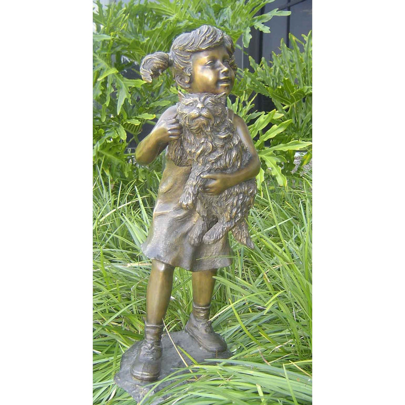 Bronze cat statue with little girl