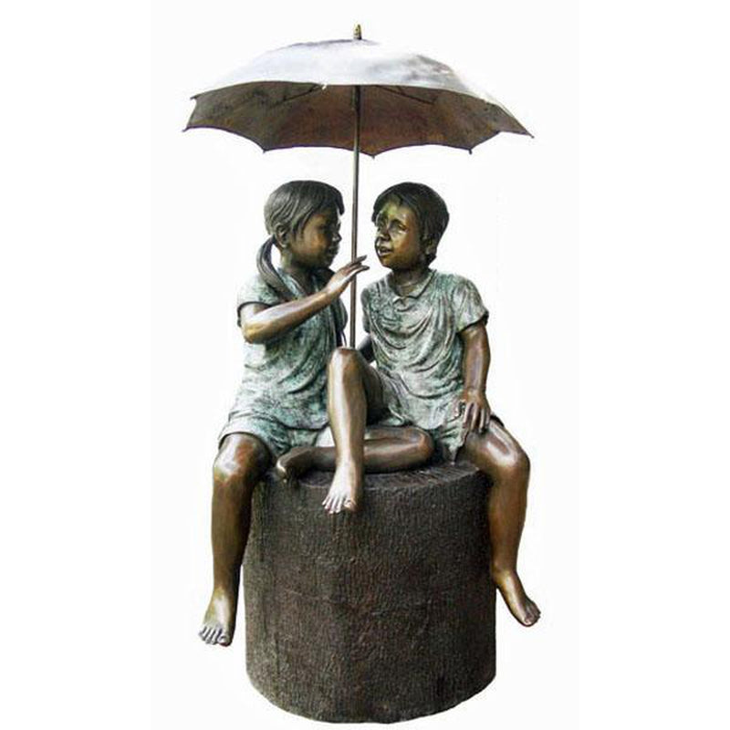 bronze statue of boy and girl under umbrella fountain