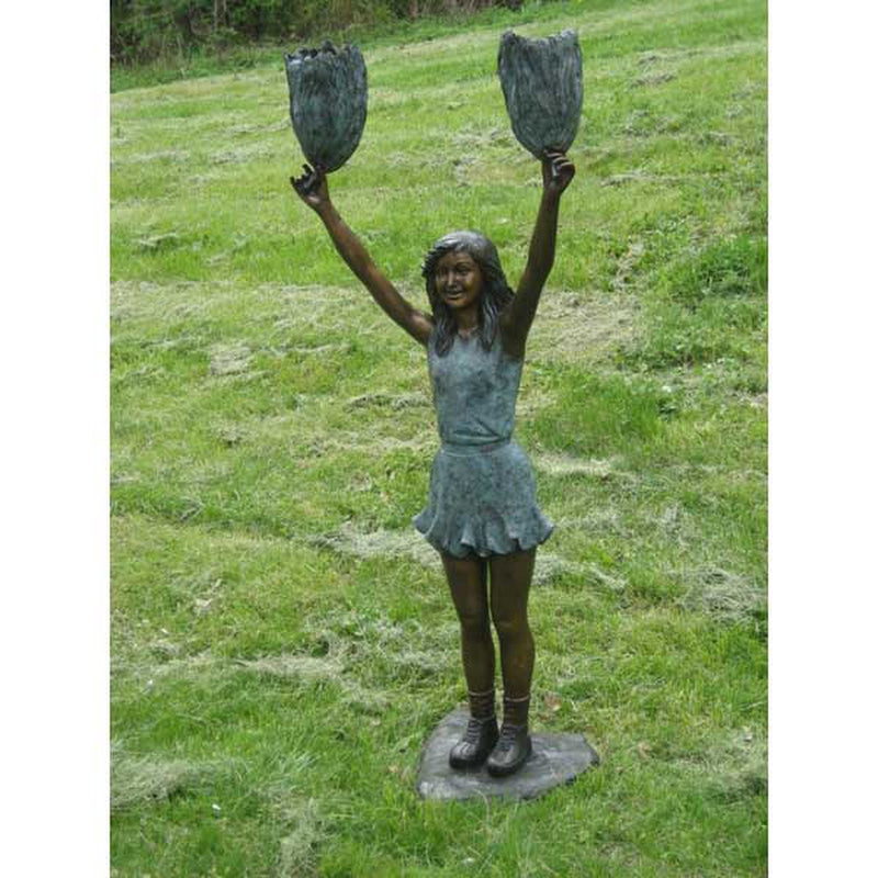 bronze statue of a girl cheerleading football statue