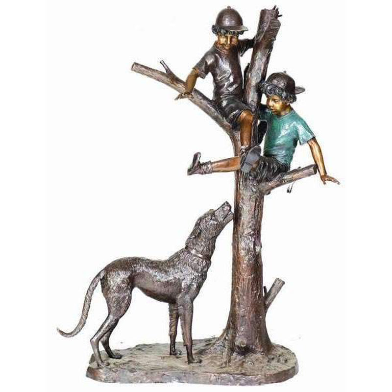 bronze statue of two boys playing in tree with dog