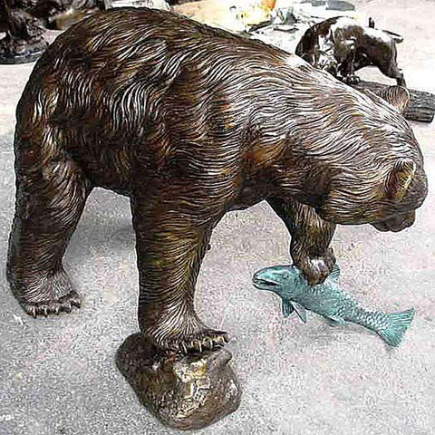 Bear Holding Fish in Paw