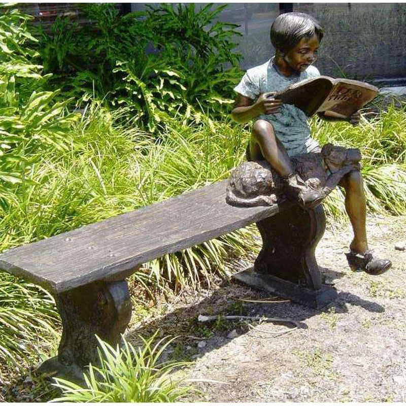 Bronze Statue of Boy Reading on a Bench with a Dog