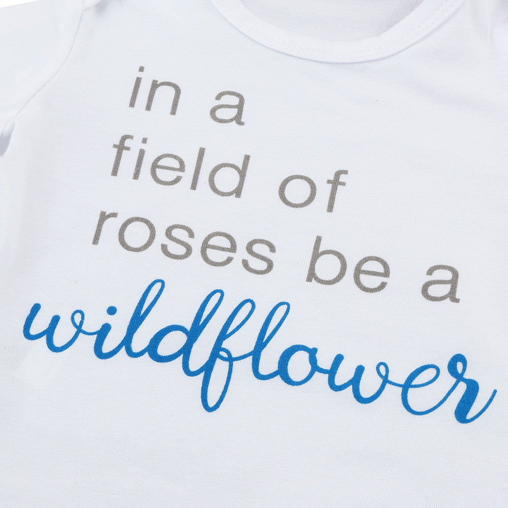 """In a field of roses be a Wildflower"" Baby Grow"