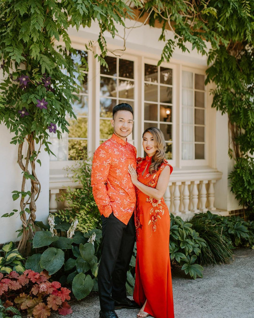 Groom and bride wearing modern traditional Chinese wedding dress and jacket