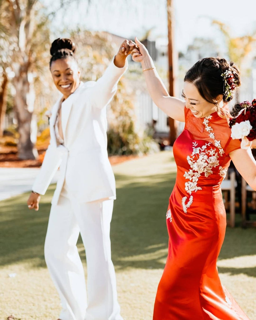 LGBTQ couple wearing traditional Chinese wedding dress