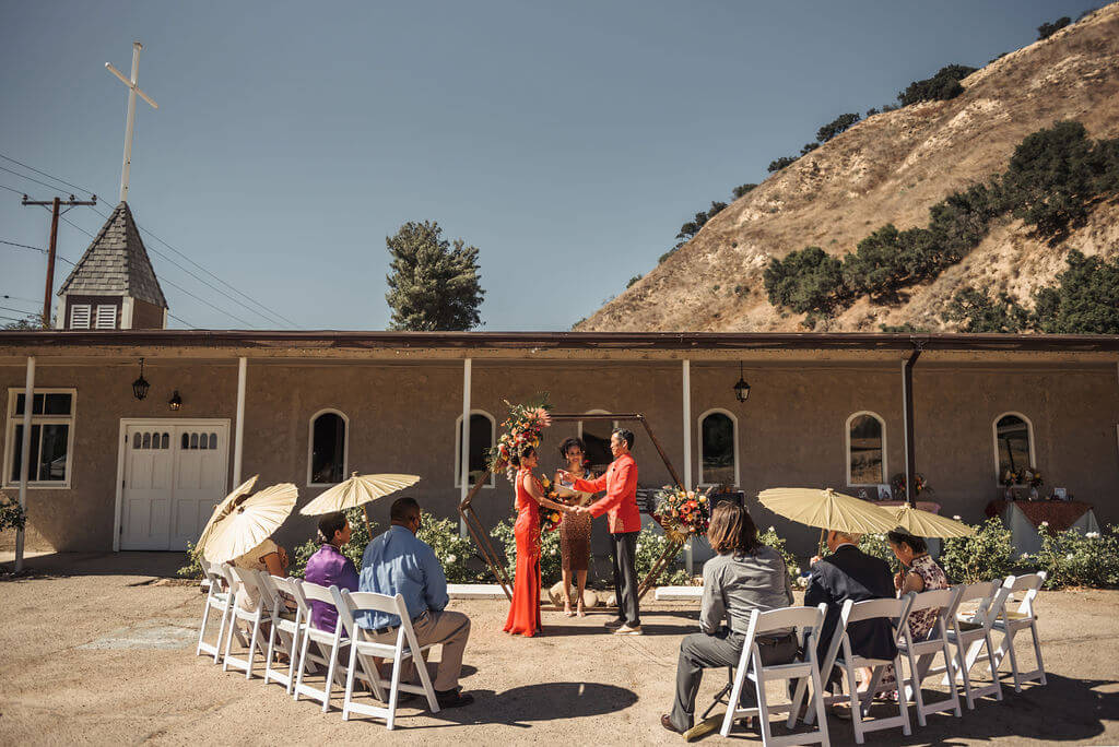 Intimate Asian American wedding outdoors
