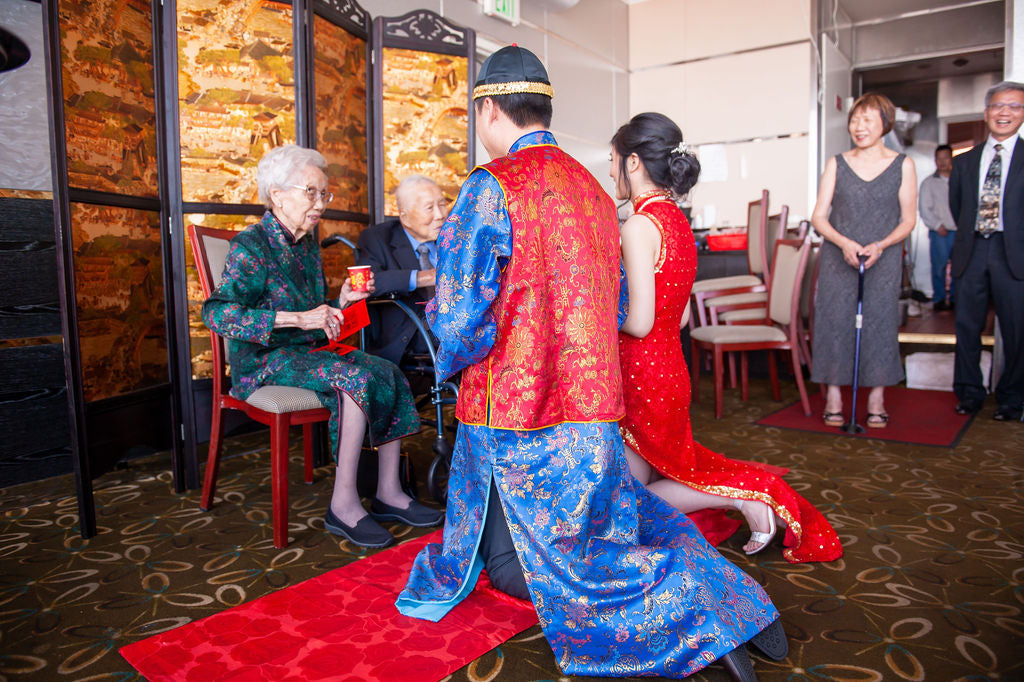 Asian American Bride Wearing Red and Gold Cheongsam for Tea Ceremony