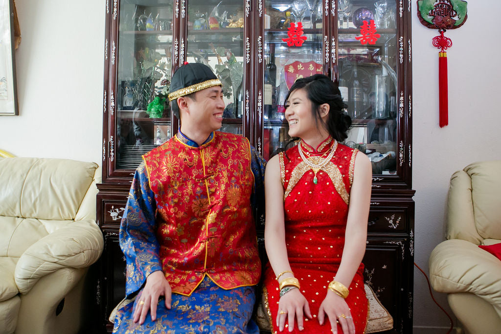 Asian American Wedding Couple Wearing Traditional Chinese Wedding Clothes