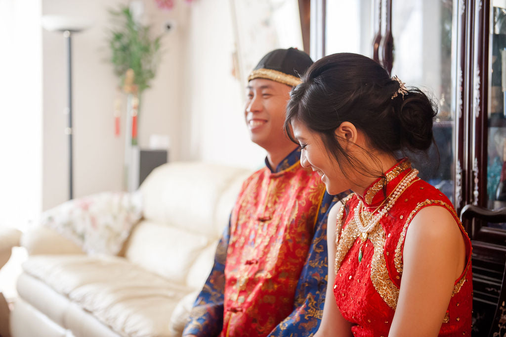 Asian American Bride Wearing Red and Gold Cheongsam