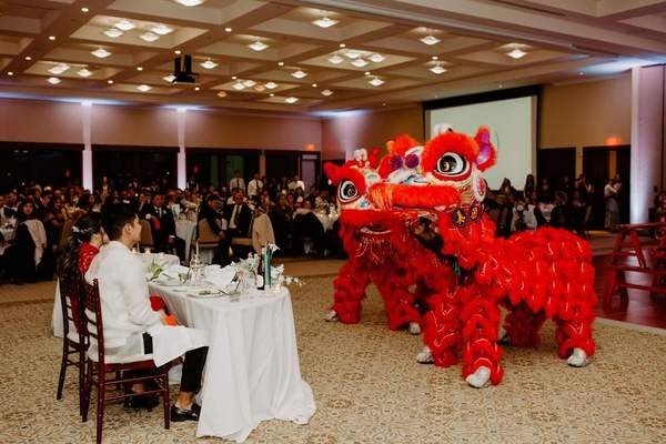 A Chinese-Filipino wedding featuring a red cheongsam and lion dancing