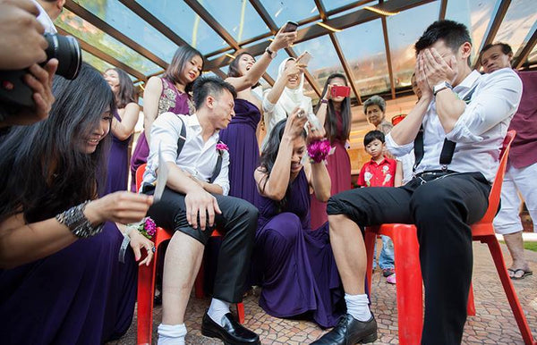 8 Chinese Traditional Door Games to Play at Your Chinese Wedding, Wax Legs