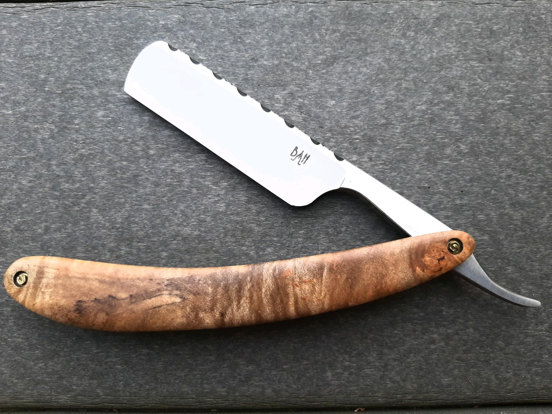 Bell & Hat razor with 52100 steel blade from Aldo Bruno, file work on the spine, Maple burl scales, and  5/8-inch round nose steel