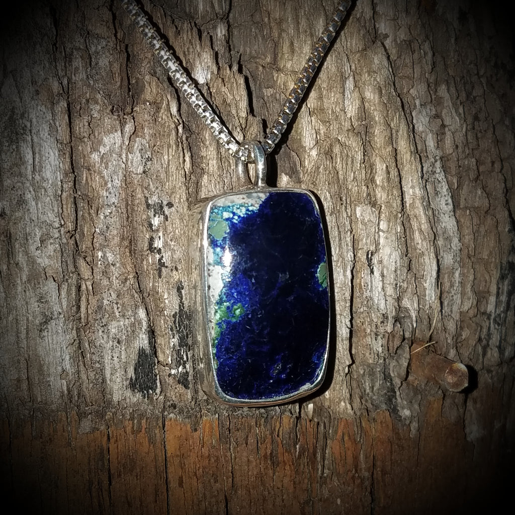 Ely Knives and Silver dark blue Lapis gem necklace; accents of green set in sterling silver, 5/8-inches wide and 1-inch tall, with 16-inch, 18-inch, or 20-inch chain.