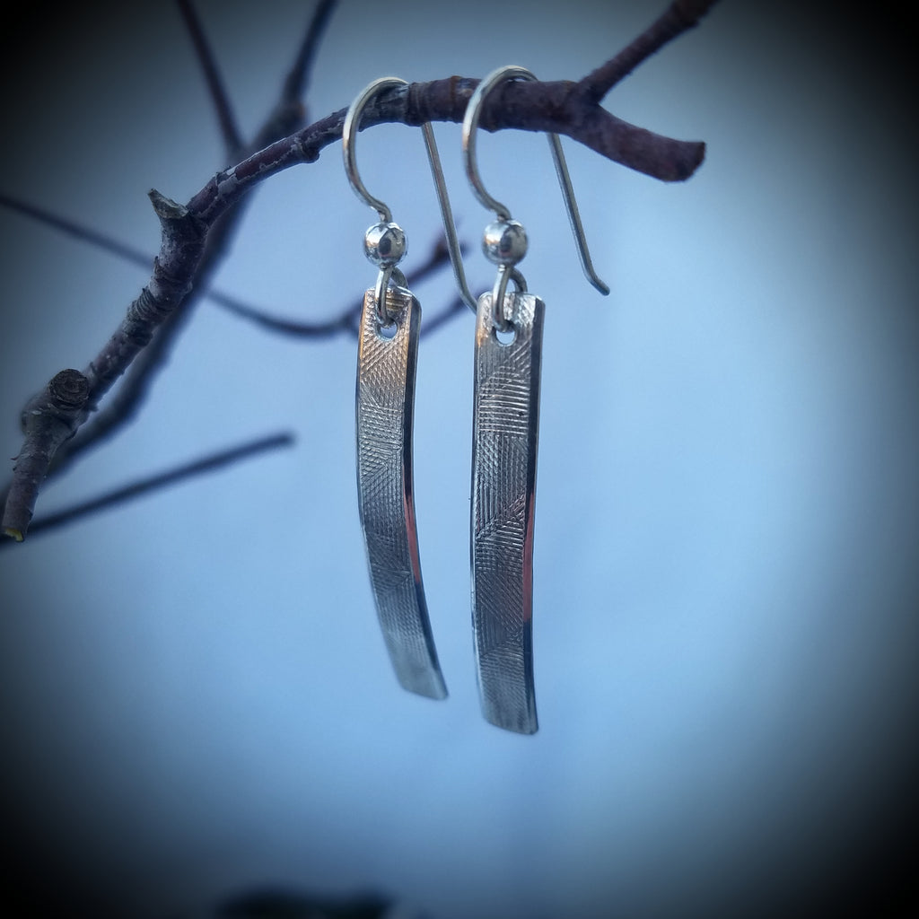 Ely Knives and Silver Curved Sterling silver earrings; 1 3/8-inch sterling silver with a soft imprint