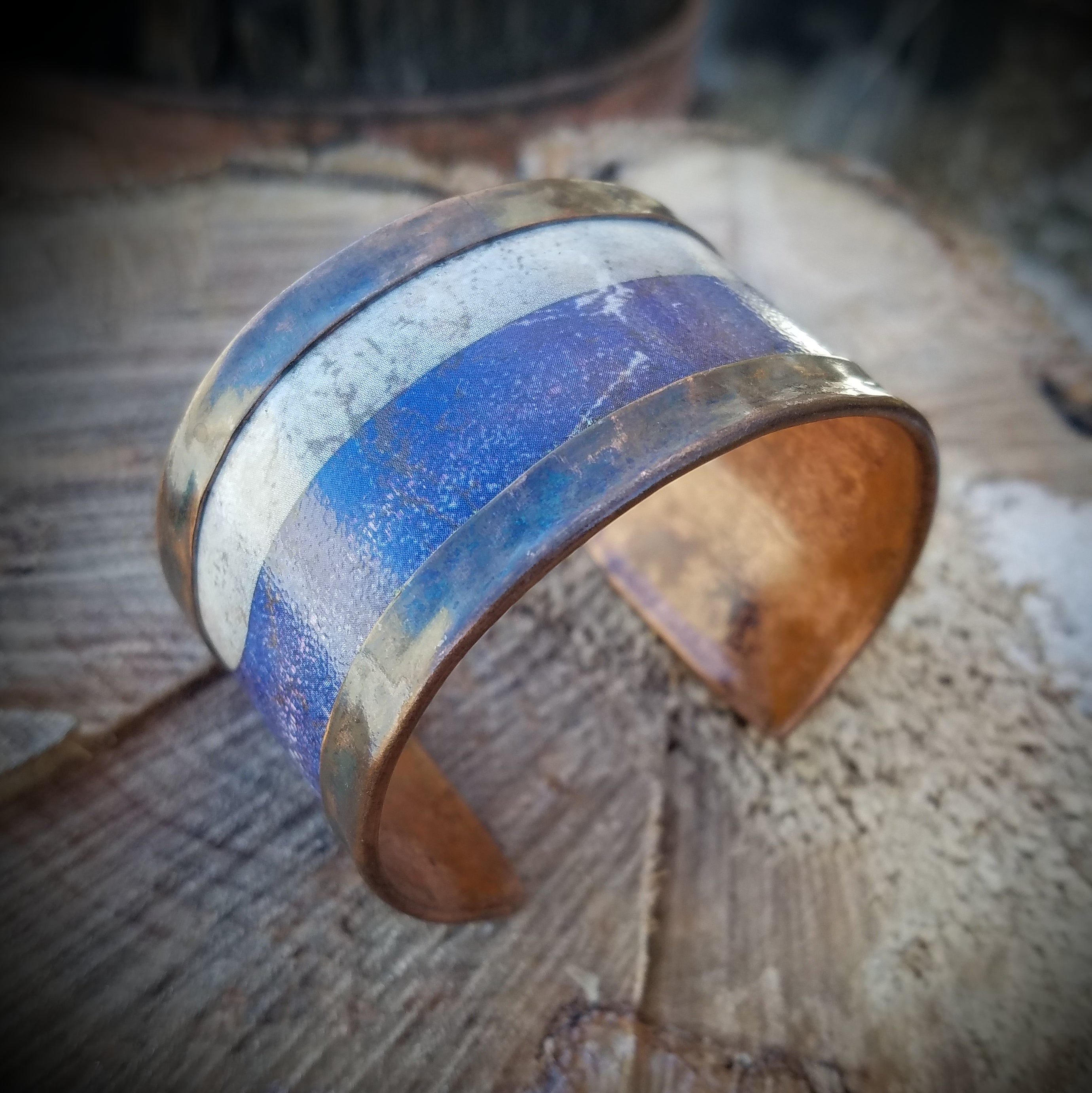 "Ely Knives and Silver Copper bracelet wrapped around antiqued metal. Approximately 1 1/2"" wide. Adjustable cuff; can be worn snug or loose."