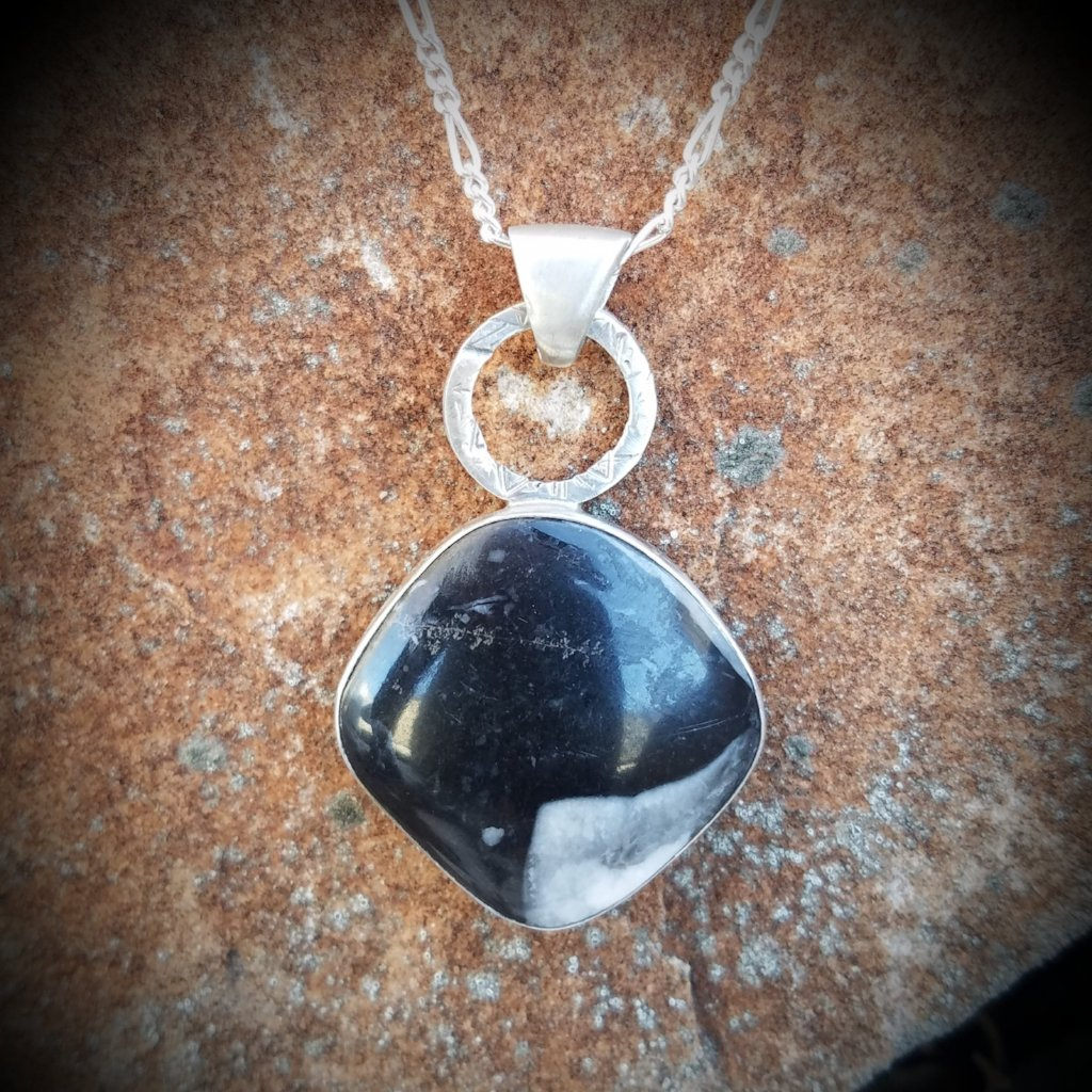Ely Knives and Silver Gemstone necklace; approximately 1 inch wide by 1 1/2 inches tall, with 16, 18, or 20 inch chain.