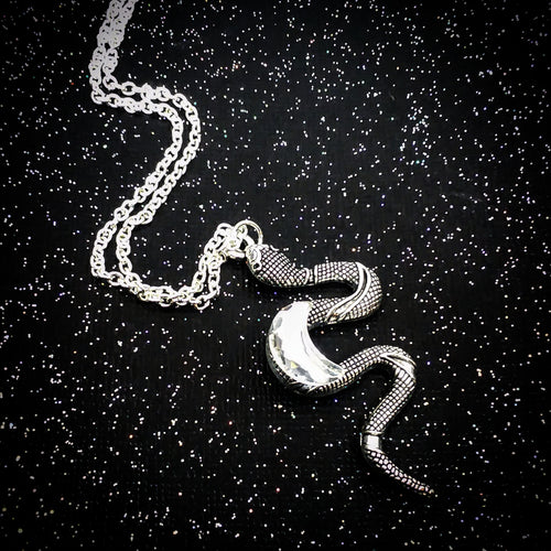 Snake necklace with rhinestone moon