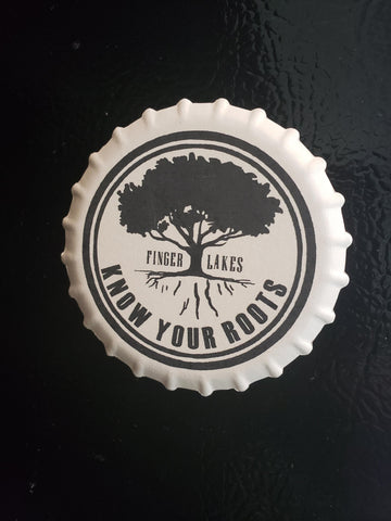Ceramic  magnet with imprint of the Know Your Roots logo in black