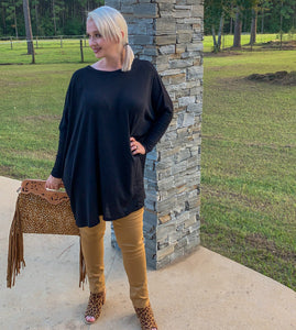 Keep them talking poncho top in black